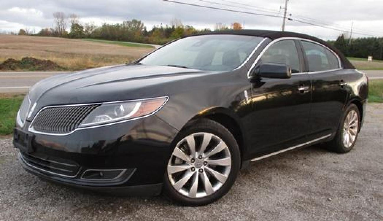 2014 Black /Black Lincoln MKS (1LNHL9EK3EG) with an 3.5L V6 DOHC 24V engine, 6-Speed Automatic transmission, located at 1725 US-68 N, Bellefontaine, OH, 43311, (937) 592-5466, 40.387783, -83.752388 - Photo #1