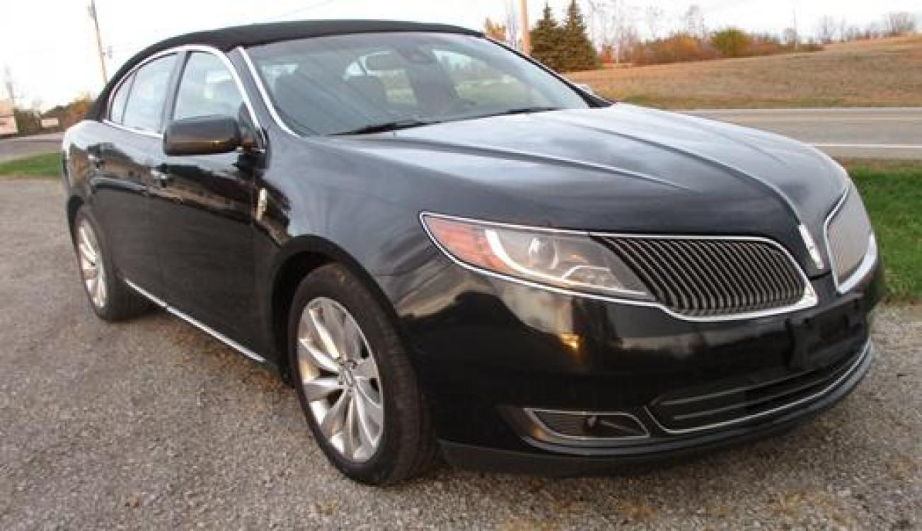 2014 Black /Black Lincoln MKS (1LNHL9EK3EG) with an 3.5L V6 DOHC 24V engine, 6-Speed Automatic transmission, located at 1725 US-68 N, Bellefontaine, OH, 43311, (937) 592-5466, 40.387783, -83.752388 - Photo #3