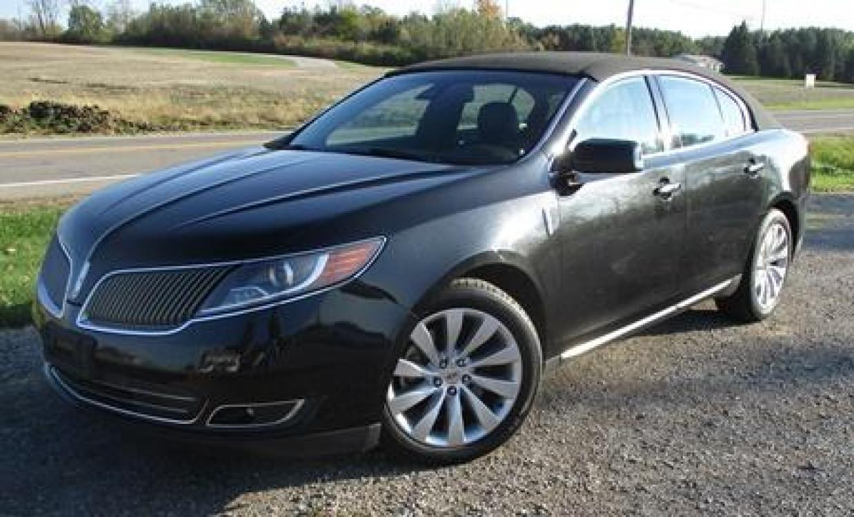 2014 Black /Black Lincoln MKS (1LNHL9EK7EG) with an 3.5L V6 DOHC 24V engine, 6-Speed Automatic transmission, located at 1725 US-68 N, Bellefontaine, OH, 43311, (937) 592-5466, 40.387783, -83.752388 - Photo #1