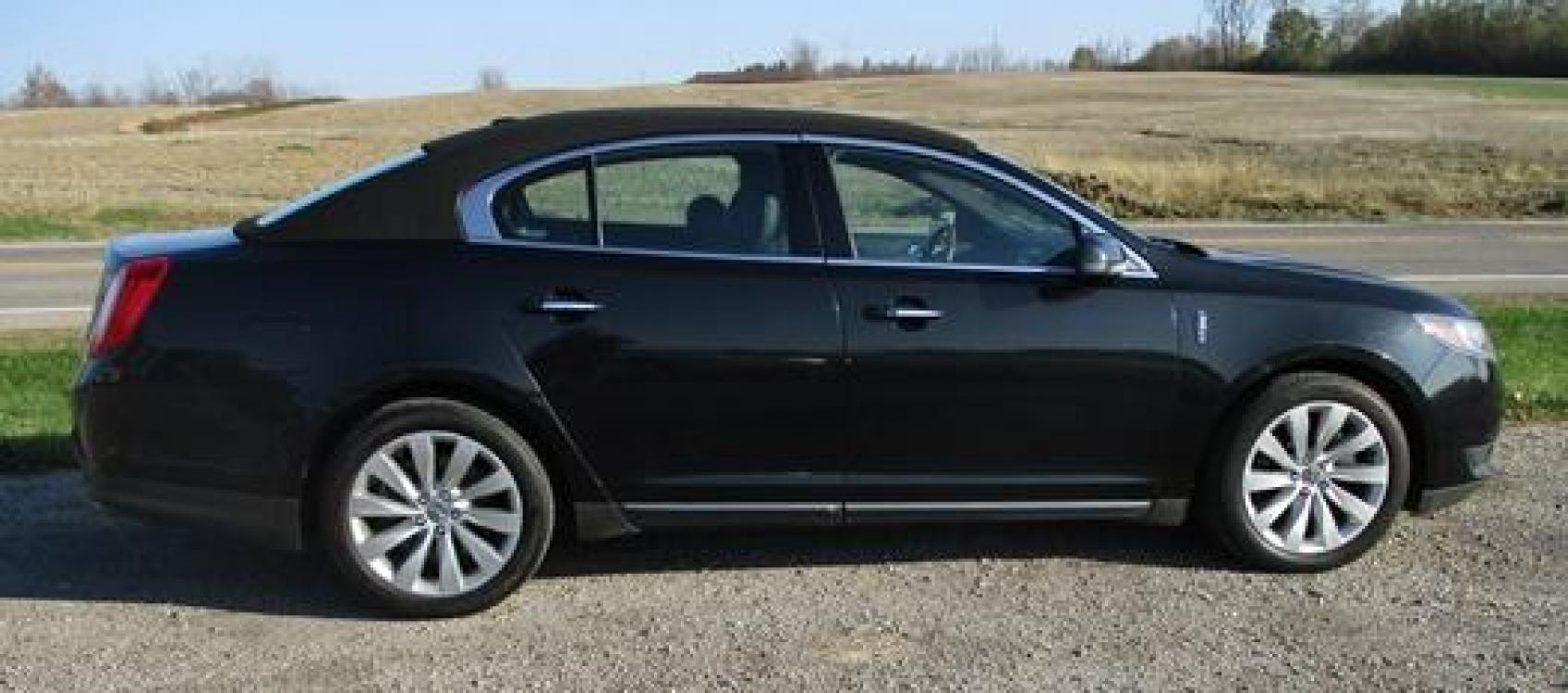 2014 Black /Black Lincoln MKS (1LNHL9EK7EG) with an 3.5L V6 DOHC 24V engine, 6-Speed Automatic transmission, located at 1725 US-68 N, Bellefontaine, OH, 43311, (937) 592-5466, 40.387783, -83.752388 - Photo #5