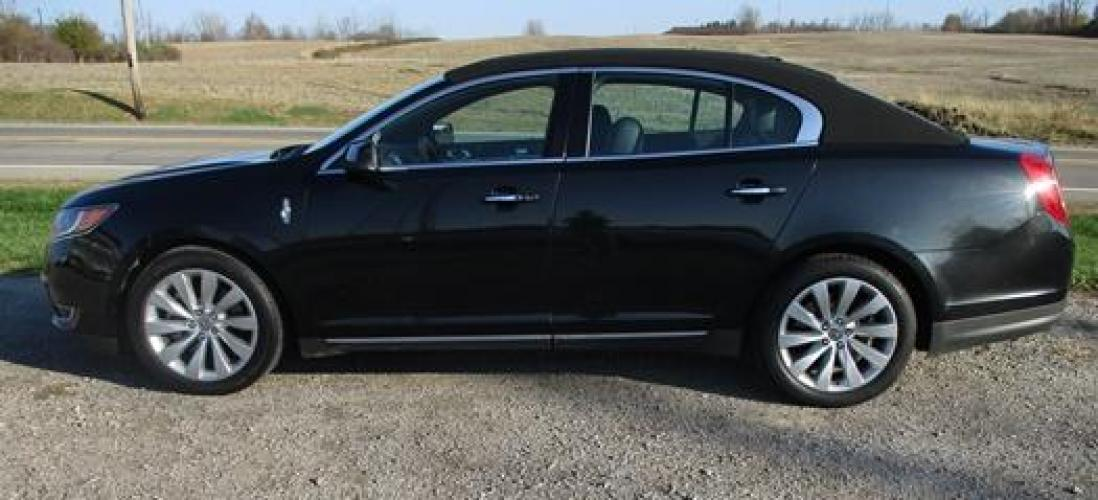 2014 Black /Black Lincoln MKS (1LNHL9EK7EG) with an 3.5L V6 DOHC 24V engine, 6-Speed Automatic transmission, located at 1725 US-68 N, Bellefontaine, OH, 43311, (937) 592-5466, 40.387783, -83.752388 - Photo #6