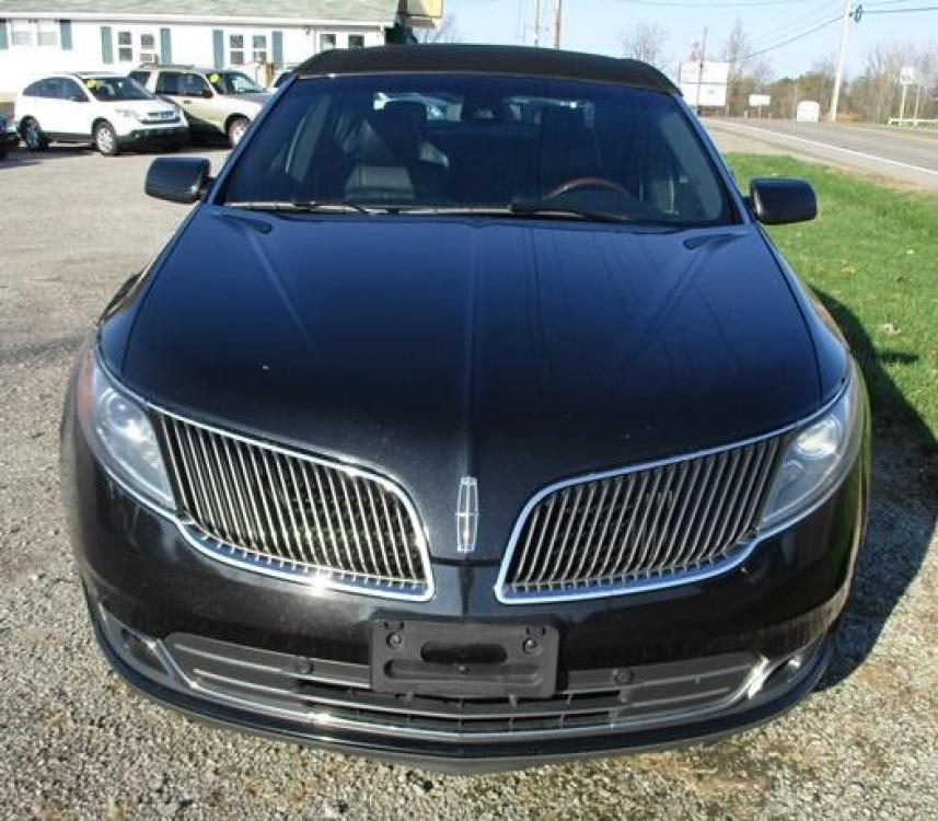 2014 Black /Black Lincoln MKS (1LNHL9EK7EG) with an 3.5L V6 DOHC 24V engine, 6-Speed Automatic transmission, located at 1725 US-68 N, Bellefontaine, OH, 43311, (937) 592-5466, 40.387783, -83.752388 - Photo #7